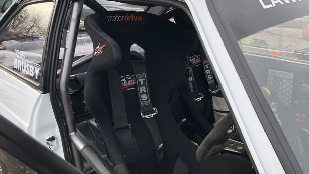 A seat inside the rally car.
